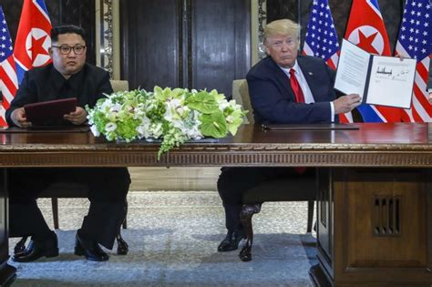 trump kim shake hands commit  complete