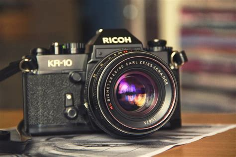 selective focus photography  black ricoh kir  camera