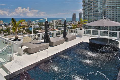 black decorative pillows miami penthouse mancave rooftop pool contemporary pool