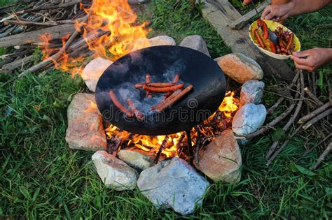 outdoor cooking sausages stock photo image