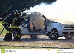 Firefighters Extinguishing Car On Fire. Stock Photo ...