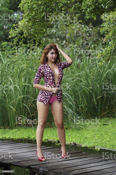 Beautiful Sexy Asian Girl Posing Topless Outdoors Stock