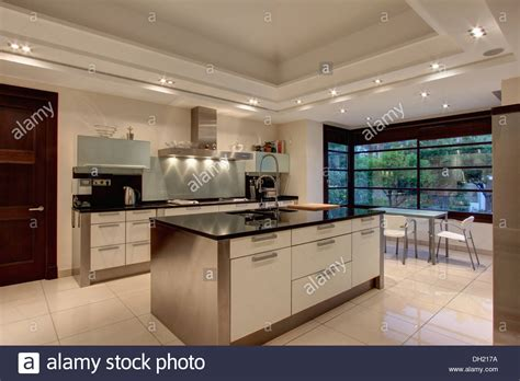 Kitchen Island With Sink - down lighting on false ceiling in modern spanish kitchen with stock photo 62125150 alamy