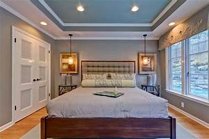 tray ceiling recessed lights bedroom transitional with