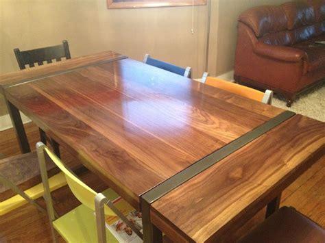 hand  black walnut dining table  welded steel base