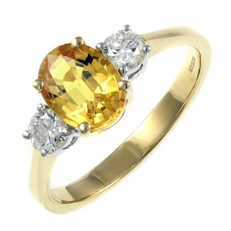 18ct Yellow Gold 160ct Yellow Sapphire & 037ct Diamond Ring. Blue Celtic Dragon Wedding Rings. Muffin Top Wedding Rings. Gold Wedding Engagement Rings. Wedding Lady Diana Engagement Rings. Flower Style Engagement Rings. Lotr Rings. Elf Wedding Rings. Osmium Wedding Rings