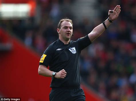 Referees Roger East, Robert Madley and Craig Pawson ...