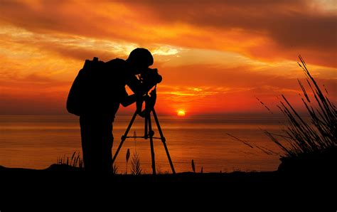 photographer  sunset silhouette  stock photo