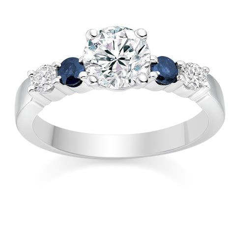round cut 0 63 carat colour side stones engagement ring in