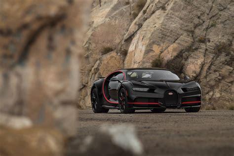 black  red bugatti chiron supercar report