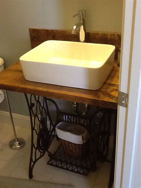 singer sewing machine base repurposed  bathroom vanity
