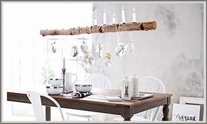 Deko äste Birke : bett mit hintergrund steinwand ~ Michelbontemps.com Haus und Dekorationen