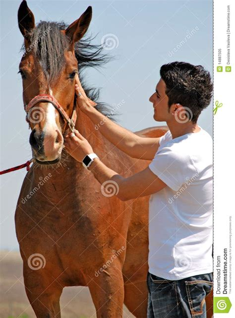 young man  horse royalty  stock photo image