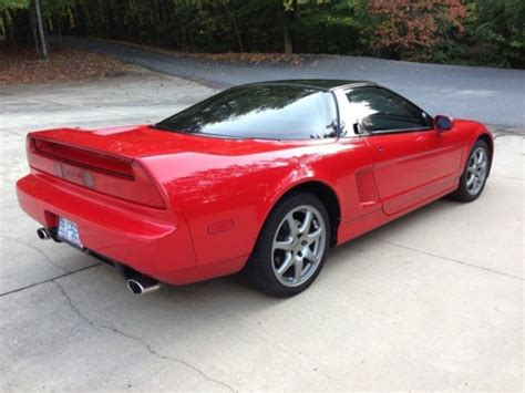 66k miles and a 5 speed 1994 acura nsx bring a trailer