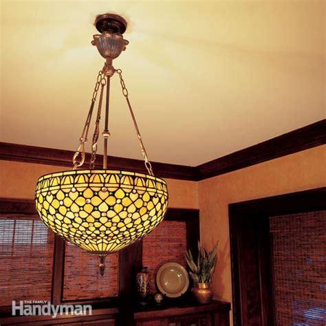 hang  ceiling light fixture  family handyman