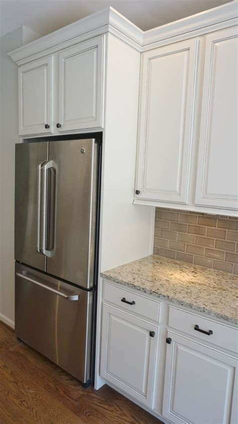 side of kitchen cabinet ideas refrigerator enclosure to give built in look with glazed