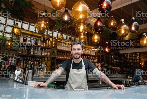 Happy Business Owner Working At A Restaurant Stock Photo ...