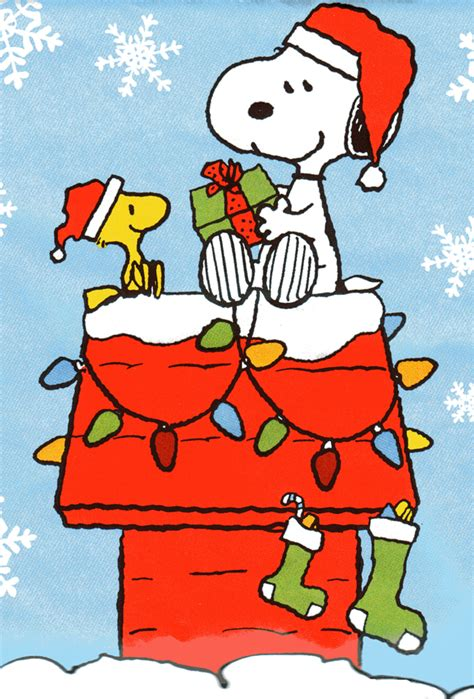 snoopy and woodstock sharing gifts at christmas