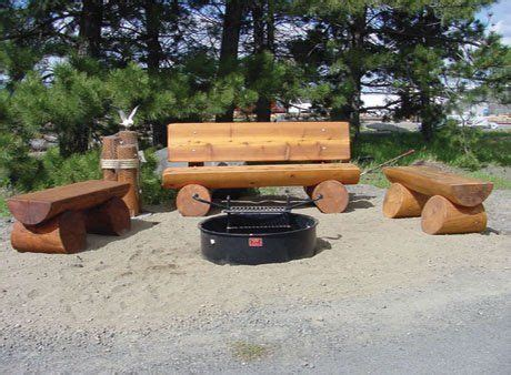 Log Bench Around A Campfire Pit In The Back Yard  For The