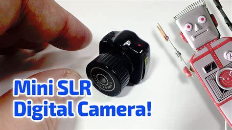 mini slr digital camera working miniature  guinness