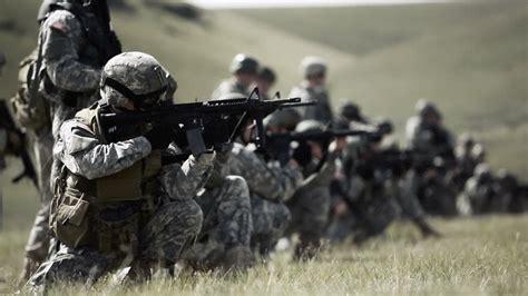Soldiers firing guns in kneeling stance - YouTube
