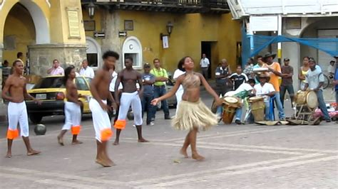 Let us now take you to a colombian music journey. Traditional Dancing in Cartagena, Colombia -- Cumbia - YouTube
