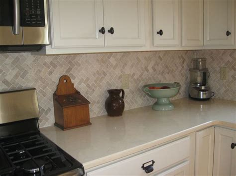 cream herringbone stone mosaic tile kitchen tile