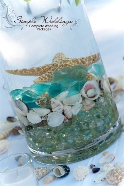 beach centerpiece with teal colors sea shells and a