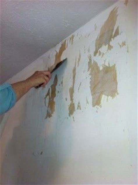 hand plaster walls  cover wallpaper  damage