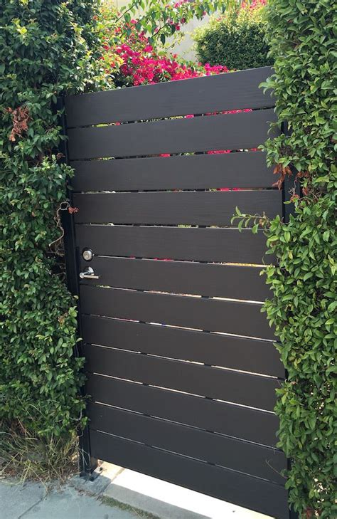 modern redwood gate    horizontal steel frame