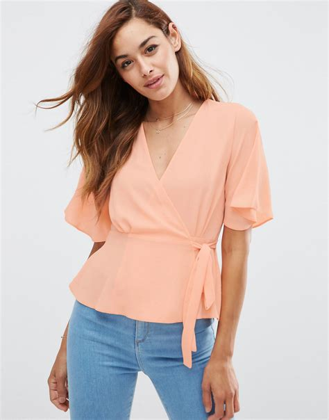 wrap front blouse asos tea blouse with wrap front in pink lyst