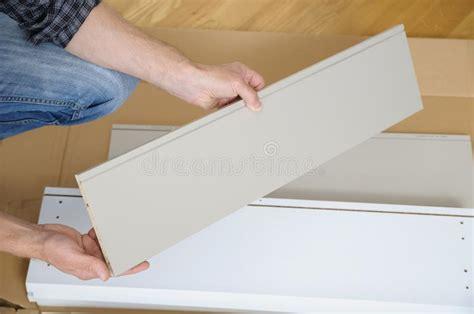man installing  white furniture stock image image  closeup living