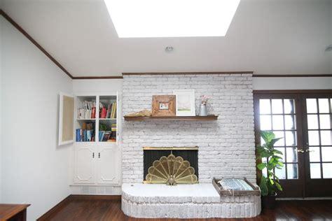 update  brick fireplace   whitewash brick  easy