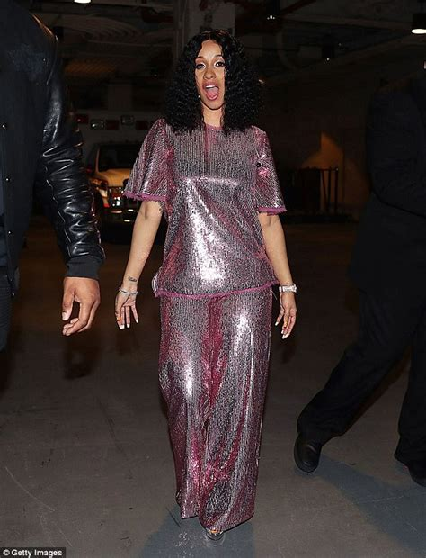 Cardi B covers up in a loose-fitting pink sequin top ...
