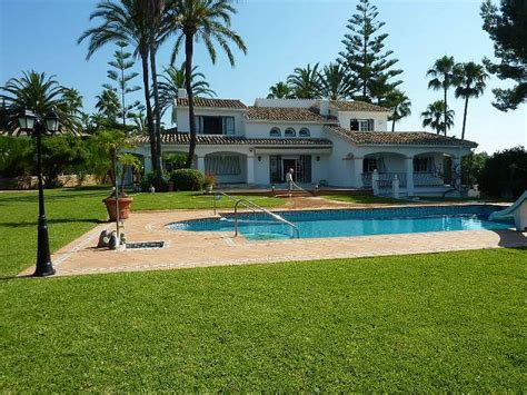 house with beautiful landscaped garden and