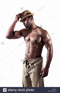 Physically fit black / African American, shirtless wearing ...