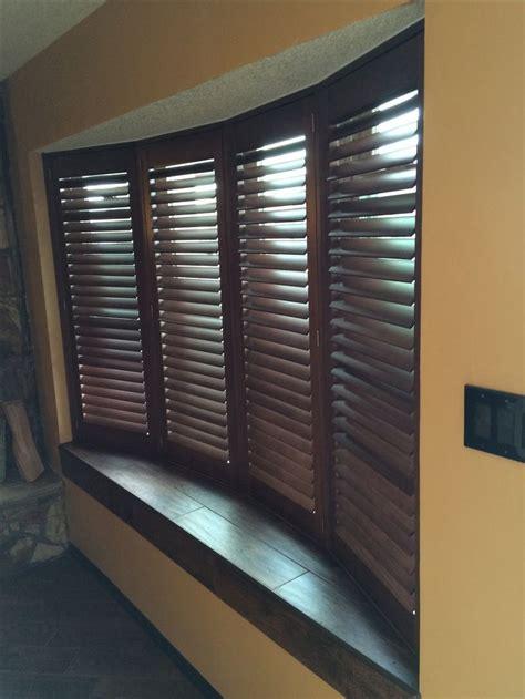 wood shutters  stylish  durable   bow window