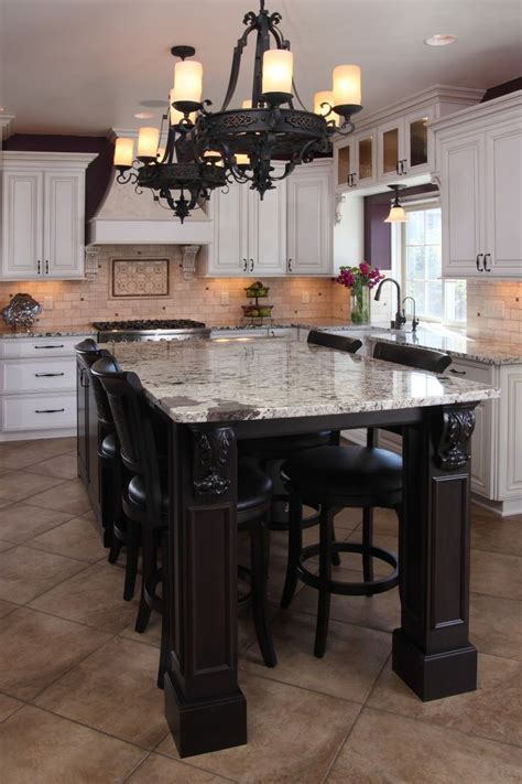 white painted glazed perimeter cabinets cherry island  custom corbels granite countertops tile backsplash custom range hood