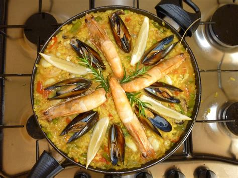cuisine paella free photo paella seafood rice food free image on
