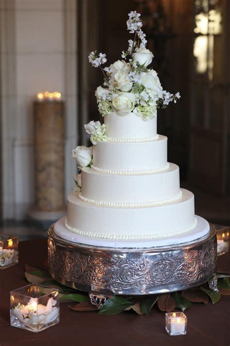 4 tier wedding cake white roses on buttercream 4 tier wedding cake wwww 1112