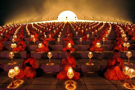 buddhist monks at a lantern lighting ceremony hd travel