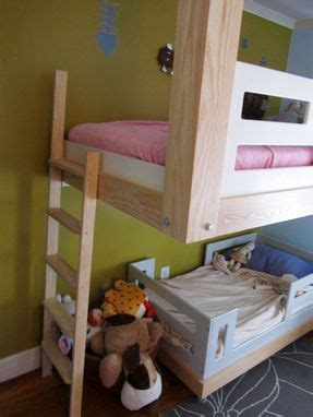 hand  architecural woodworking floating bunk bed