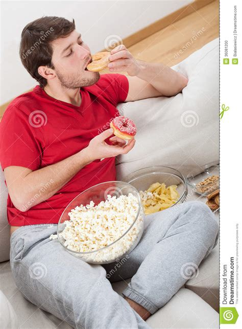 Lazy Guy On A Couch With Food Stock Photo  Image 36081200