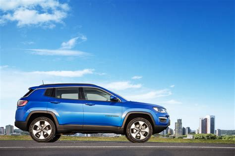 jeep compass limited blue 2017 jeep compass poses for the camera in all trim levels