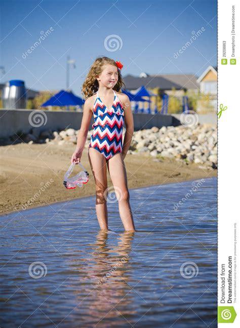 young girl   lake neighbourhood stock  image