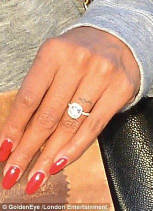 engaged rowland cannot stop smiling as flashes that diamond ring a cupcake