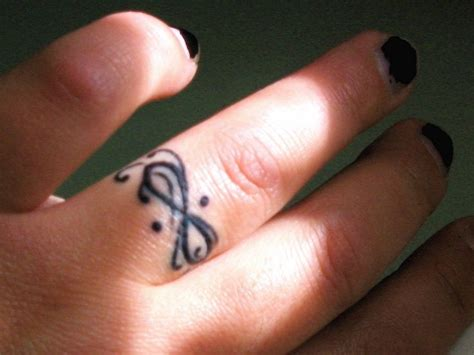 Infinity Tattoo On Finger Designs, Ideas And Meaning