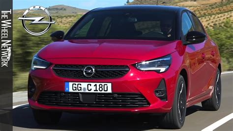 opel corsa chili red driving interior exterior