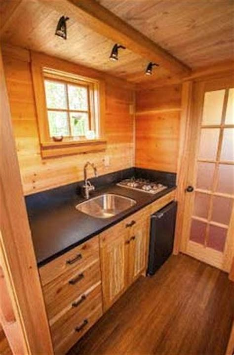 cozy tiny house affixed   trailer  secured