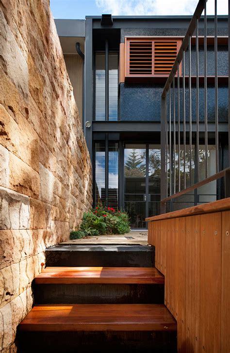 bold black  wood exterior     terrace